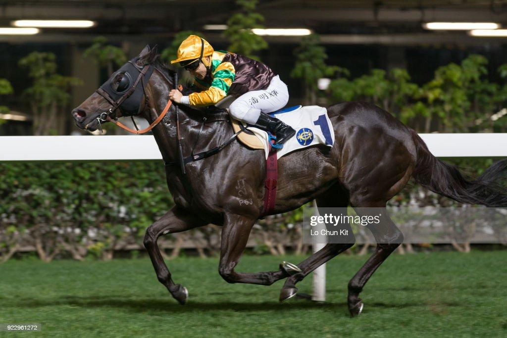 Jockey Matthew Poon Ming-fai riding Winfull Patrol wins the Race 1 Yuk Sau Handicap at Happy Valley Racecourse on February 21, 2018 in Hong Kong, Hong Kong.