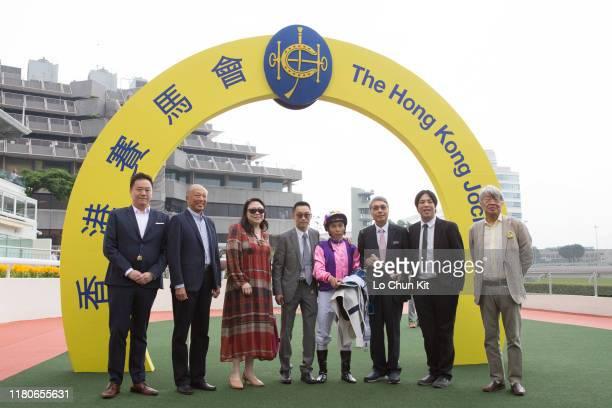 Jockey Matthew Poon Mingfai trainer Jimmy Ting Koonho and owner Dr Gene Tsoi Wai Wang celebrate after King's Race winning Race 4 Tak Wah Handicap at...