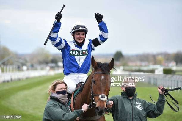 Jockey Megan Nicholls celebrates on 'Knappers Hill' after winning the Standard Open Flat Race on Grand National Day of the Grand National Festival at...