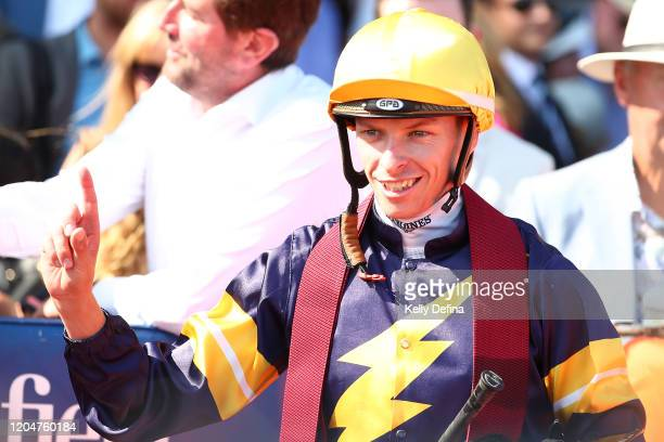 Jockey Michael Dee reacts after riding Alabama Express to win race 8 the Neds CF Orr Stakes during Melbourne Racing at Caulfield Racecourse on...