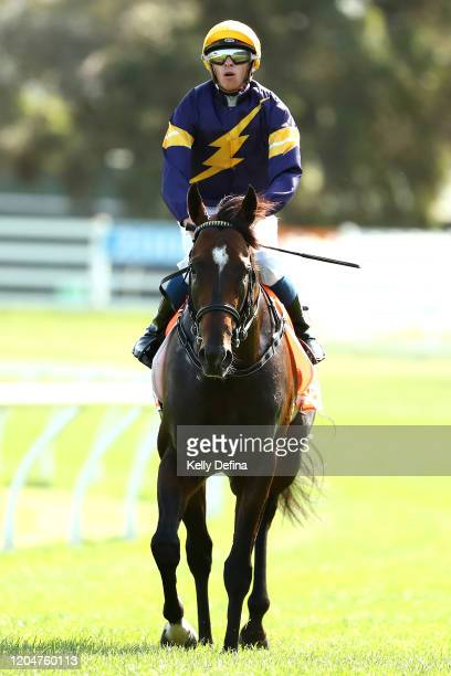 Jockey Michael Dee returns to scale on Alabama Express after winning race 8 the Neds CF Orr Stakes during Melbourne Racing at Caulfield Racecourse on...