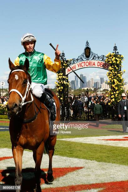 Jockey Michael Dee returns to scale on Shillelagh after winning race 8 the Kennedy Mile on Derby Day at Flemington Racecourse on November 4 2017 in...