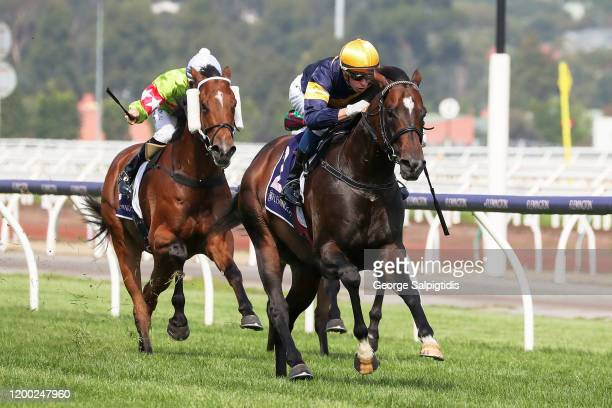 Jockey Michael Dee rides Alabama Express during Race 3 Donate to Salvation Army Disaster Appeal during Melbourne Racing at Flemington Racecourse on...