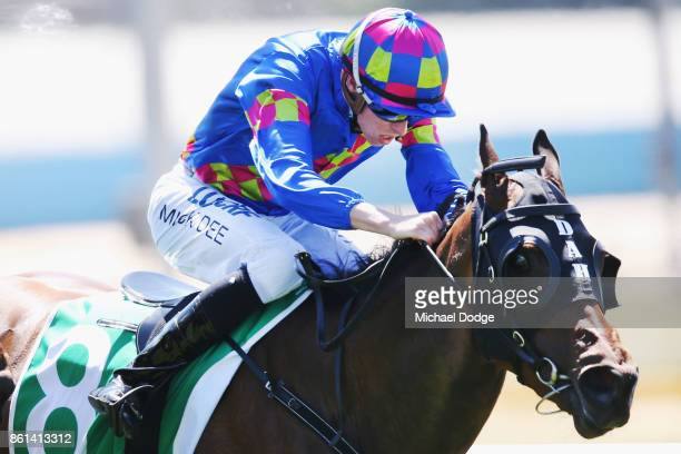 Jockey Michael Dee riding Prepare To Win wins race 1 the Wilson Medic Handicap during Cranbourne Cup Day at on October 15 2017 in Cranbourne Australia