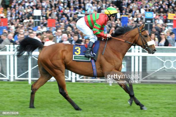 Jockey Michael Hills on Devotion To Duty goes to post in the Addleshaw Goddard Dee Stakes