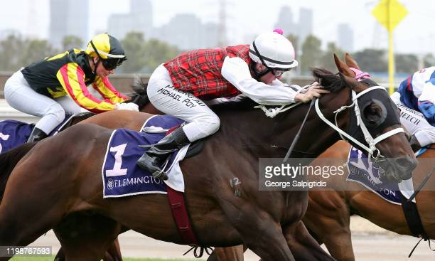 Jockey Michael Poy riding The Lord Mayor wins Race 6, Bluegrass Bar Trophy during Melbourne Racing at Flemington Racecourse on January 11, 2020 in...