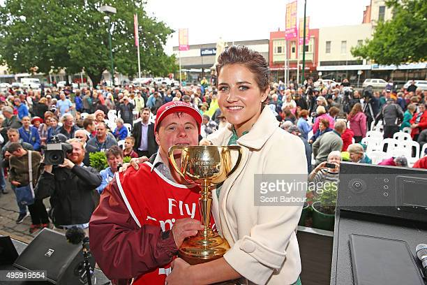 Jockey Michelle Payne and her brother Steven Payne who has Down syndrome and works as a strapper pose with the cup after Michelle Payne riding Prince...