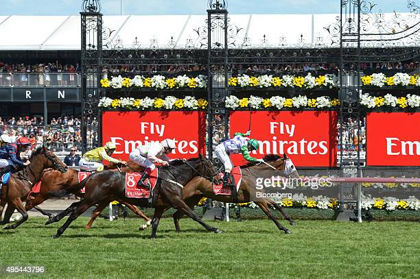 Jockey Michelle Payne right races Prince of Penzance towards the finish line during the Melbourne Cup race at the Flemington racecourse in Melbourne...