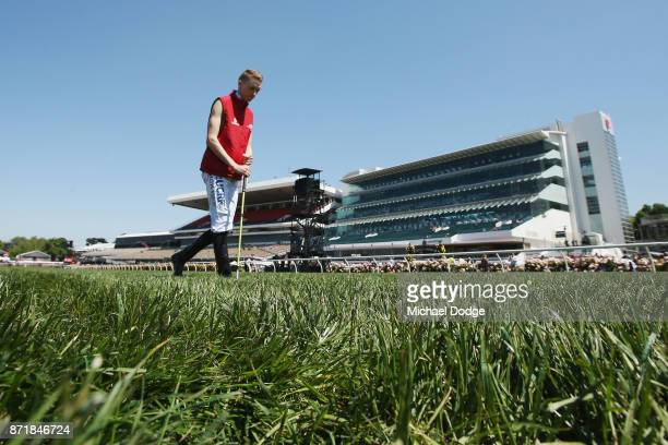 Jockey Mick Dee inspects the track on 2017 Oaks Day at Flemington Racecourse on November 9 2017 in Melbourne Australia
