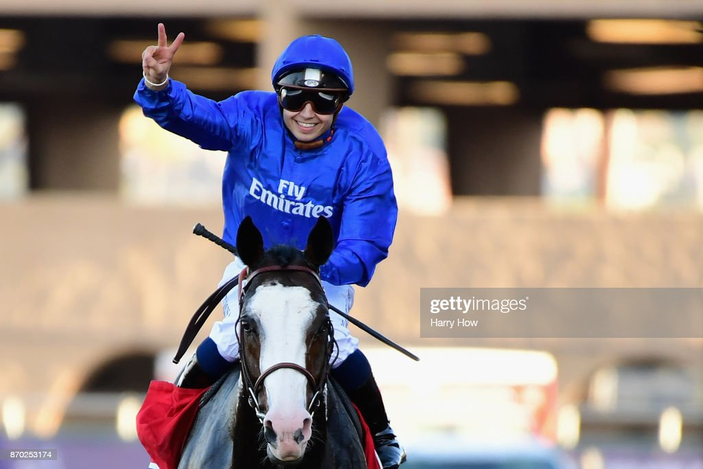 Jockey Mickael Barzalona celebrates after riding Talismanic (#1) to a win in the Longines Breeders' Cup Turf on day two of the 2017 Breeders' Cup World Championship at Del Mar Race Track on November 4, 2017 in Del Mar, California.