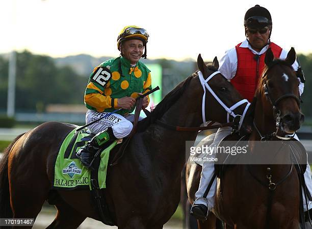 Jockey Mike Smith celebrates after guiding Palace Malice to victory during the 145th running of the Belmont Stakes at Belmont Park on June 8 2013 in...