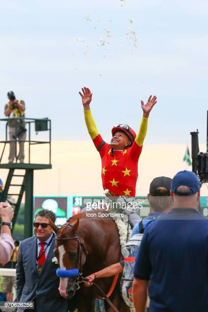 Jockey Mike Smith celebrates after riding Justify to winning the Belmont Stakes and the Triple Crown on June 9 2018 at Belmont Park in Hempstead NY