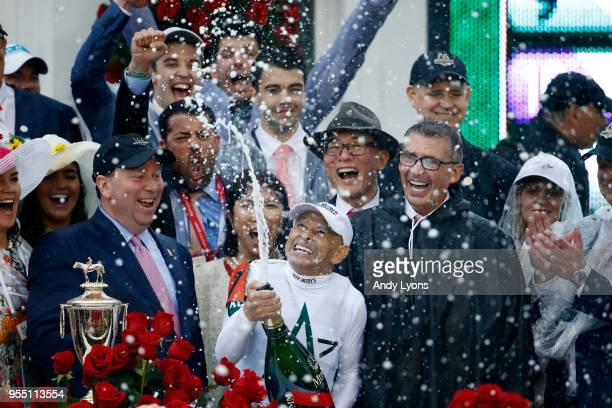 Jockey Mike Smith celebrates after winning the 144th running of the Kentucky Derby at Churchill Downs on May 5 2018 in Louisville Kentucky