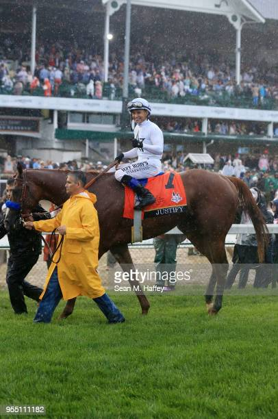 Jockey Mike Smith celebrates atop of Justify after winning the 144th running of the Kentucky Derby at Churchill Downs on May 5 2018 in Louisville...