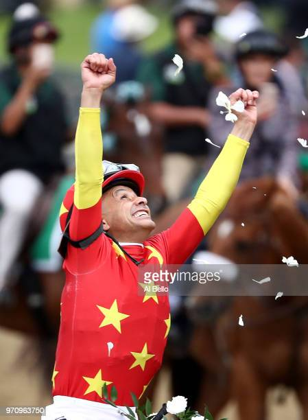 Jockey Mike Smith celebrates atop of Justify during the 150th running of the Belmont Stakes at Belmont Park on June 9 2018 in Elmont New York Justify...