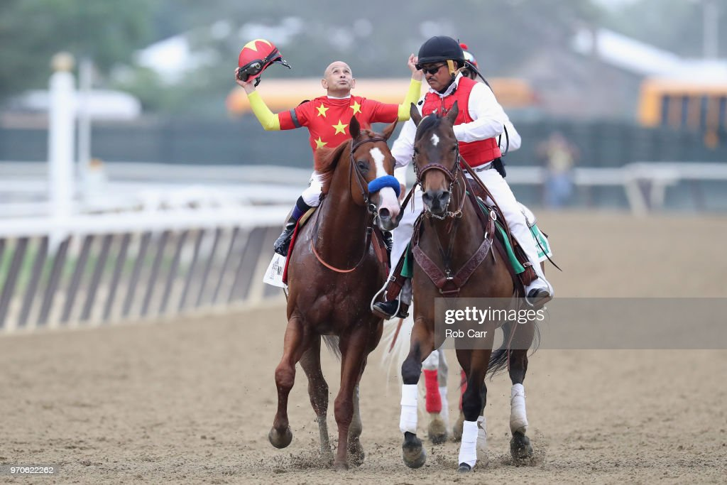 Jockey Mike Smith celebrates atop of Justify #1 the 150th running of the Belmont Stakes at Belmont Park on June 9, 2018 in Elmont, New York. Justify becomes the thirteenth Triple Crown winner and the first since American Pharoah in 2015.