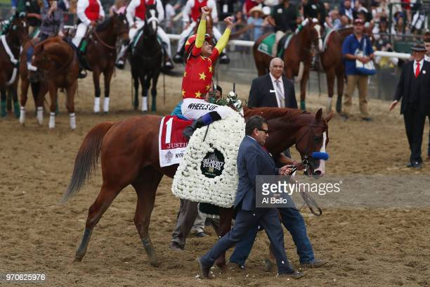 Jockey Mike Smith celebrates atop of Justify the 150th running of the Belmont Stakes at Belmont Park on June 9 2018 in Elmont New York Justify...