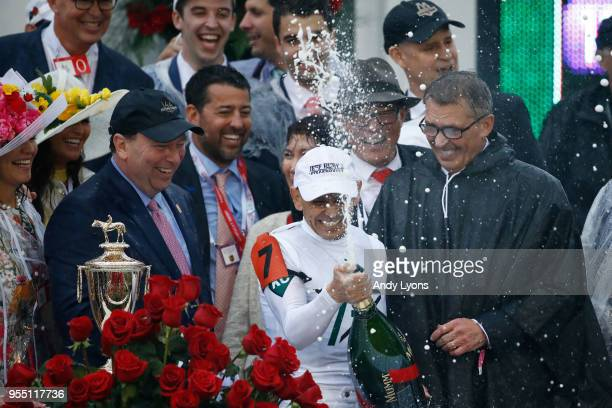 Jockey Mike Smith celebrates in the winner's circle after winning the 144th running of the Kentucky Derby at Churchill Downs on May 5 2018 in...