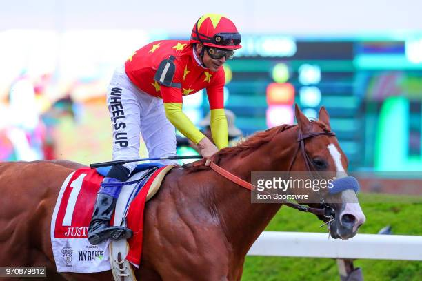 Jockey Mike Smith is all smiles after crossing the finish line riding Justify after winning the 150th Belmont Stakes and the Triple Crown on June 9...