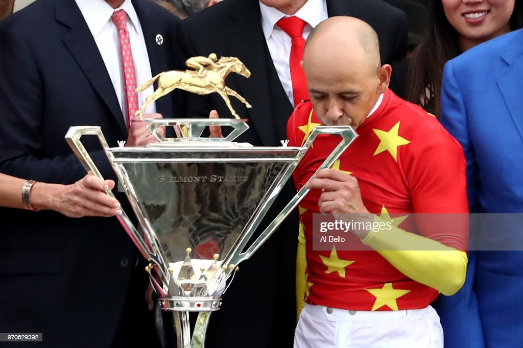 Jockey Mike Smith kisses the Triple Crown Trophy during the 150th running of the Belmont Stakes at Belmont Park on June 9, 2018 in Elmont, New York. Justify becomes the thirteenth Triple Crown winner and the first since American Pharoah in 2015.