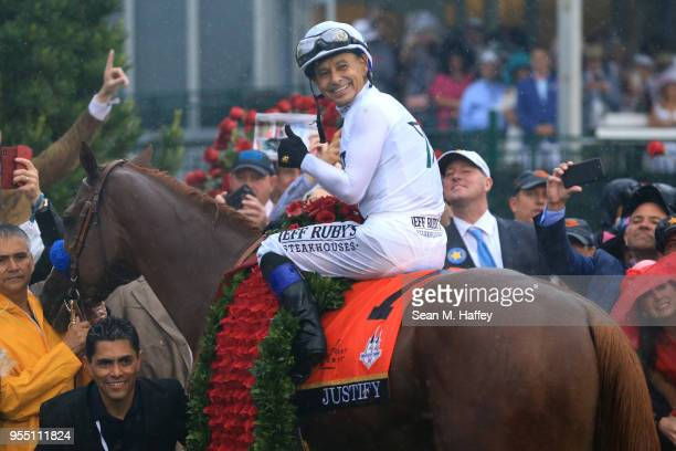 Jockey Mike Smith poses for a photo in the winner's circle atop of Justify after winning the 144th running of the Kentucky Derby at Churchill Downs...