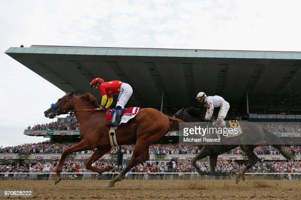 Jockey Mike Smith reacts atop of Justify during the 150th running of the Belmont Stakes at Belmont Park on June 9 2018 in Elmont New York Justify...