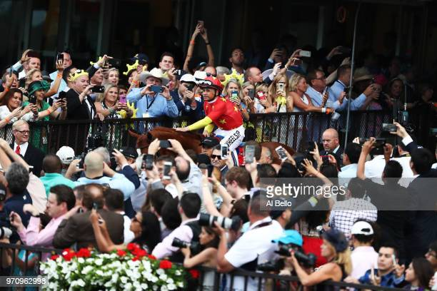 Jockey Mike Smith reacts atop of Justify the 150th running of the Belmont Stakes at Belmont Park on June 9 2018 in Elmont New York Justify becomes...