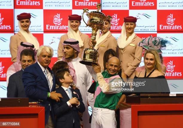 Jockey Mike Smith riding Arrogate celebrates with the trophy and trainer Bob Baffert after winning the Dubai World Cup Sponsored By Emirates Airline...