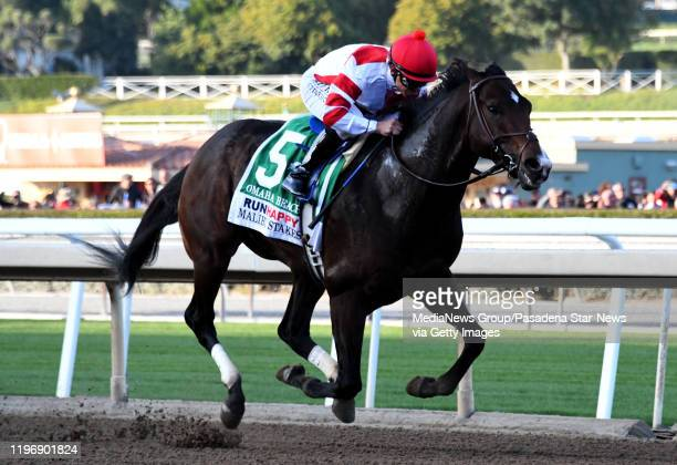 Jockey Mike Smith riding Omaha Beach wins the Malibu Stakes during opening day horse racing at Santa Anita Park on Saturday December 28 2019 in...