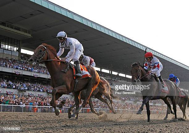 Jockey Mike Smith rises in his saddle as he rode Drosselmeyerto the win along with Fly Down ridden by John Velazquez who finished second and First...