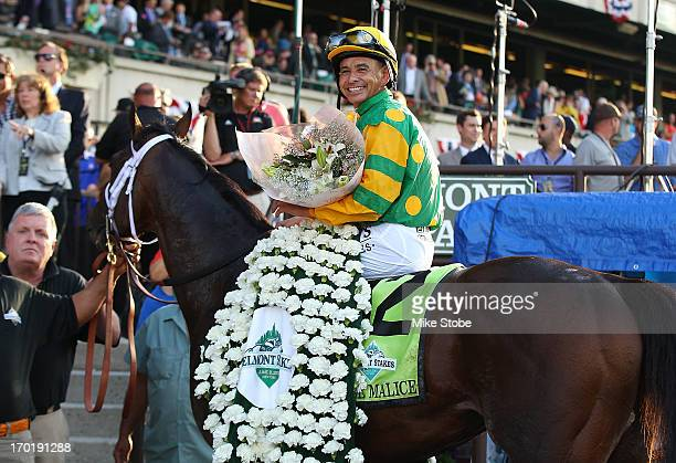 Jockey Mike Smith sits aboard Palace Malice in the winners circle after winning the 145th running of the Belmont Stakes at Belmont Park on June 8...
