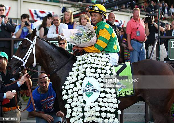 Jockey Mike Smith sits abourd Palace Malice in the winners circle after winning the 145th running of the Belmont Stakes at Belmont Park on June 8...