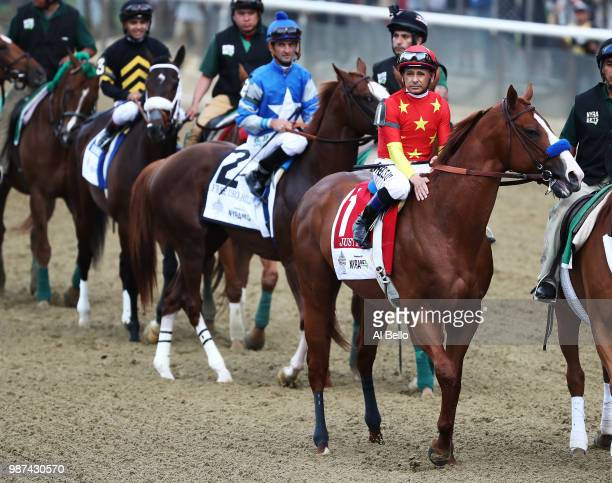Jockey Mike Smith sits atop of Justify before the 150th running of the Belmont Stakes at Belmont Park on June 9 2018 in Elmont New York Justify...