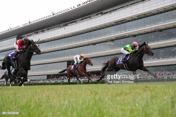 Jockey Mirco Demuro riding Satono Crown competes to win the Takarazuka Kinen at Hanshin Racecourse on June 25 2017 in Takarazuka Hyogo Japan