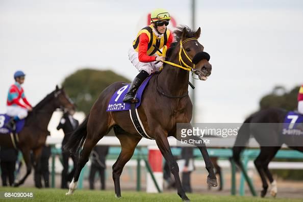 Jockey Mirco Demuro riding Sounds Of Earth during the Arima