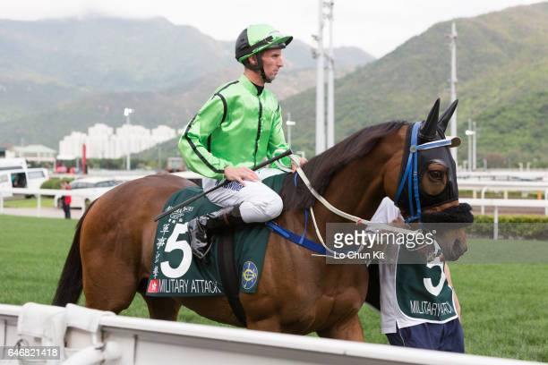 Jockey Nash Rawiller riding Military Attack during Race 8 Audemars Piguet Queen Elizabeth II Cup at Sha Tin racecourse on April 24 2016 in Hong Kong...