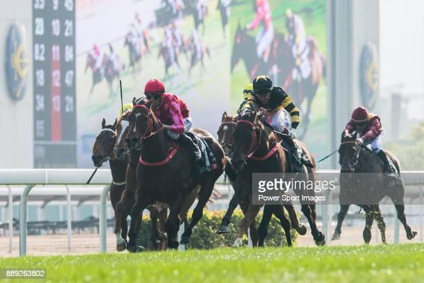 Jockey Nash Rawiller riding Mr Stunning defeats Jockey Olivier Doleuze riding D B Pin in the Longines Hong Kong Sprint during the Longines Hong Kong...
