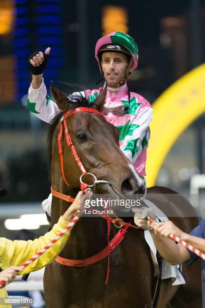 Jockey Nash Rawiller riding Our Honour wins the Race 1 Bank Street Handicap at Happy Valley Racecourse on October 18, 2017 in Hong Kong, Hong Kong.