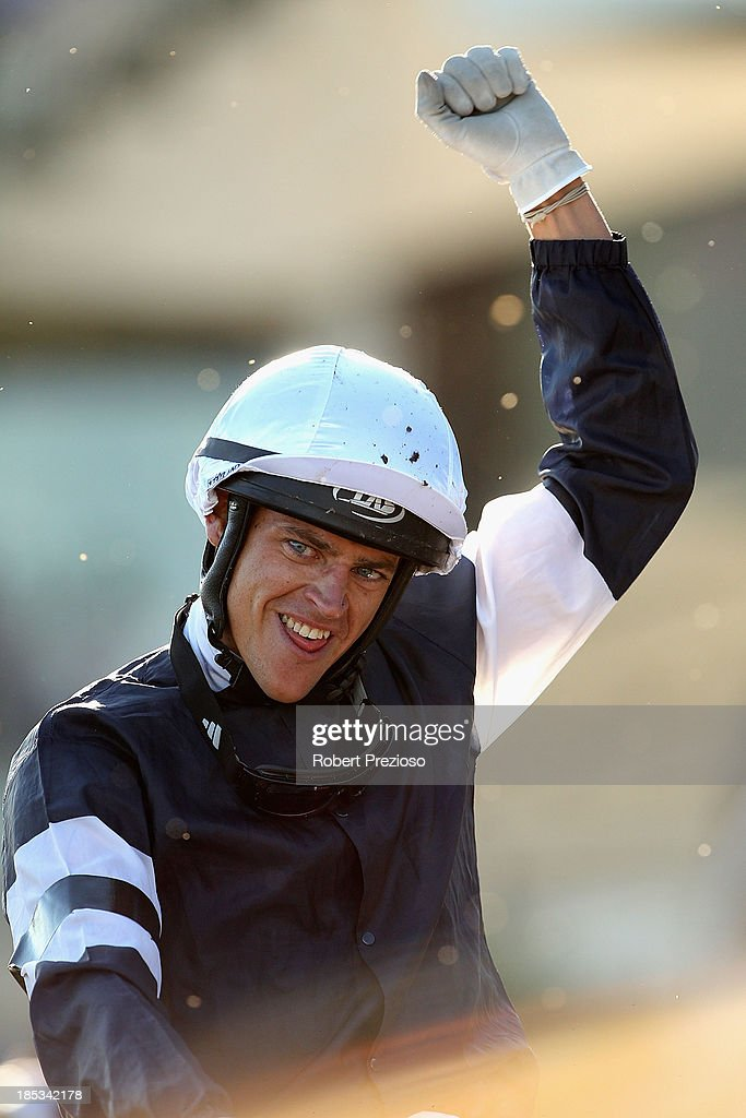 Jockey Nicholas Hall riding Fawkner returns to scale and celebrates winning Race 10 the BMW Caulfield Cup during Caulfield Cup day at Caulfield Racecourse on October 19, 2013 in Melbourne, Australia.