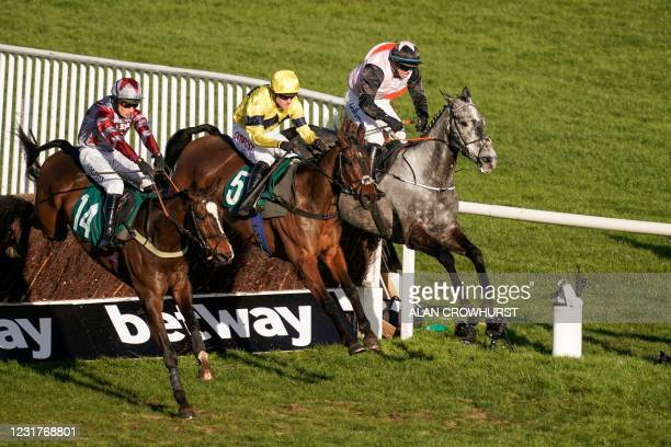 Jockey Nick Scholfield rides Sky Pirate to win the Johnny Henderson Grand Annual Challenge Cup Handicap Chase horse race on Day Two of the Cheltenham...