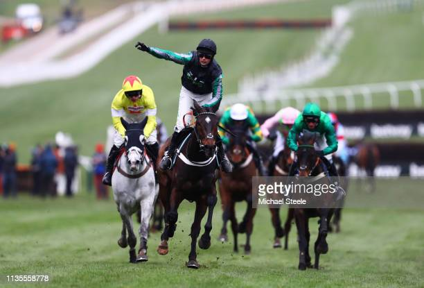 Jockey Nico de Boinville celebrates as he rides Altior to victory during the Betway Queen Mother Champion Chase on Ladies Day of the Cheltenham...