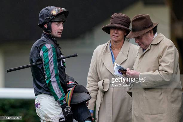 Jockey Nico de Boinville chats with Nicky Henderson at Ascot Racecourse on February 15 2020 in Ascot England