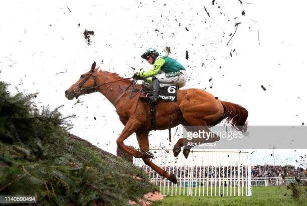 Jockey Nico de Boinville riding Topofthegame clears the last fence in the Betway Mildmay Novices' Chase during Ladies Day at Aintree Racecourse on...