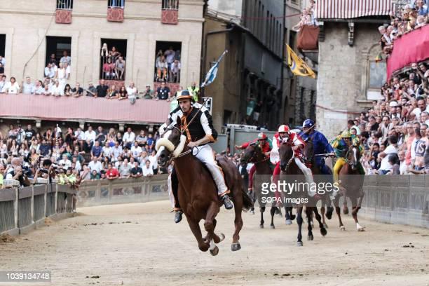Jockey of the the contrada Lupa Giuseppe Zedde known as Gingillo seen riding his horse Portgo Alabe during the Palio di Siena horse race Gingillo...