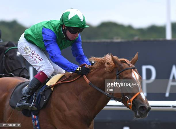 Jockey Oisin Murphy and the horse Talbot approach the finish line to win the British Stallion Studs EBF Maiden Stakes at Lingfield Park on June 08,...
