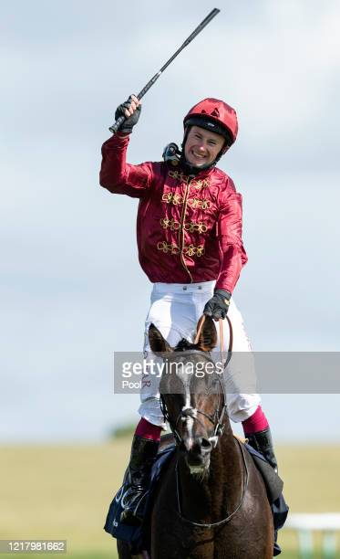 Jockey Oisin Murphy celebrates after victory onboard Kameko in the Qipco 2000 Guineas Stakes at Newmarket Racecourse on June 06 2020 in Newmarket...