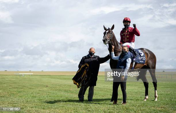 Jockey Oisin Murphy celebrates with stable staff after victory onboard Kameko in the Qipco 2000 Guineas Stakes at Newmarket Racecourse on June 06...
