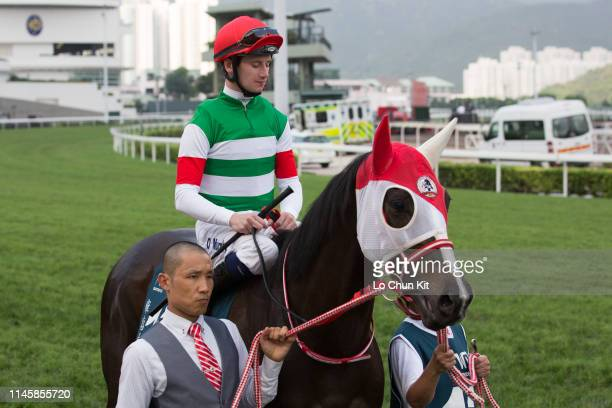 Jockey Oisin Murphy riding Lys Gracieux during Race 8 The FWD Queen Elizabeth II Cup at Sha Tin Racecourse on April 28 2019 in Hong Kong