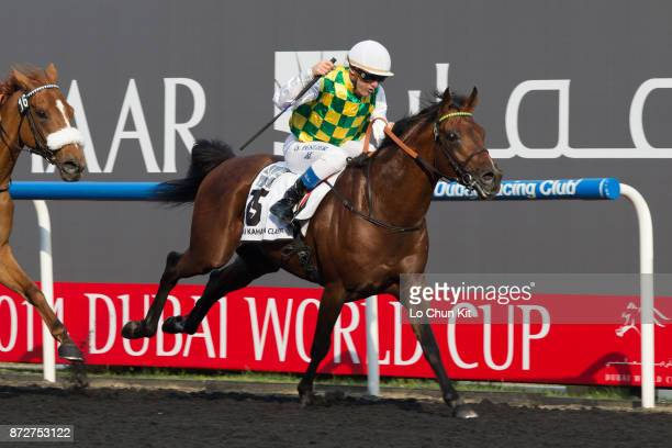 Jockey Olivier Peslier riding Rabbah De Carrere wins the Dubai Kahayla Classic during the Dubai World Cup race day at the Meydan racecourse on March...