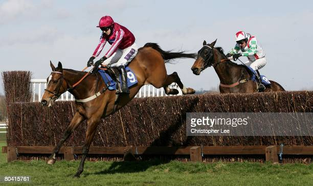 Jockey P J Brennan riding Island Flyer jumps the final hurdle in the lead to win The Montpelier Re Novices Handicap Steeple Chase at Newbury...